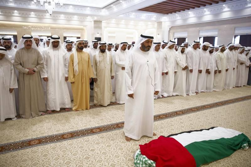 AL AIN, ABU DHABI, UNITED ARAB EMIRATES - January 28, 2018: (L-R) HH Sheikh Saud bin Rashid Al Mu'alla, UAE Supreme Council Member and Ruler of Umm Al Quwain, HH Sheikh Mohamed bin Zayed Al Nahyan, Crown Prince of Abu Dhabi and Deputy Supreme Commander of the UAE Armed Forces, HH Sheikh Mohamed bin Rashid Al Maktoum, Vice-President, Prime Minister of the UAE, Ruler of Dubai and Minister of Defence, HH Sheikh Tahnoon bin Mohamed Al Nahyan, Ruler's Representative in Al Ain Region, HH Sheikh Humaid bin Rashid Al Nuaimi, UAE Supreme Council Member and Ruler of Ajman, HE Dr Mohamed Matar Salem bin Abid Al Kaabi Chairman of the UAE General Authority of Islamic Affairs and Endowments, HH Lt General Sheikh Saif bin Zayed Al Nahyan, UAE Deputy Prime Minister and Minister of Interior, and other dignitaries, attend the funeral prayers of the late HH Sheikha Hessa bin Mohamed Al Nahyan, at Al Mutarad Grand Mosque. ( Mohamed Al Bloushi for Crown Prince Court - Abu Dhabi ) ---