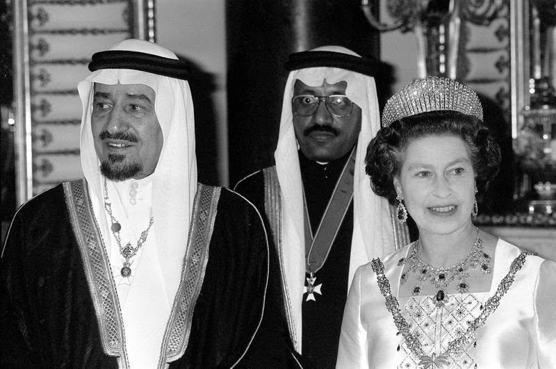 Queen Elizabeth II and King Khalid of Saudi Arabia at a State banquet at Buckingham Palace.