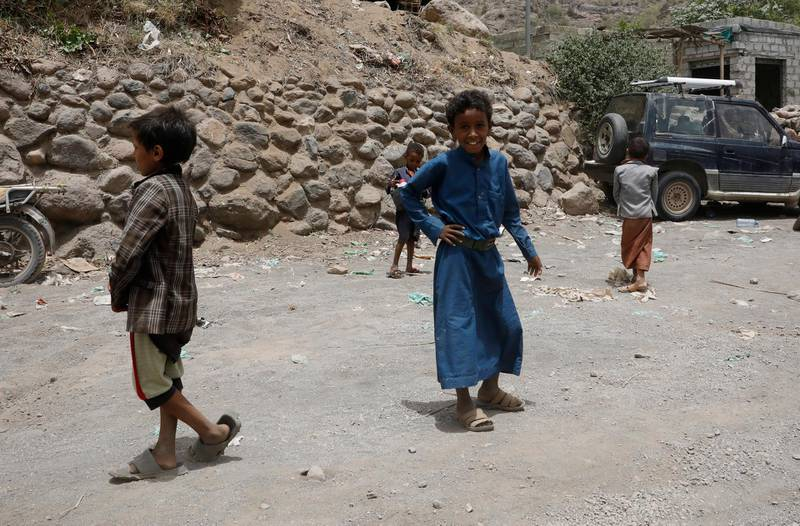 epa09284096 Yemeni children walk through a road in the remote district of Bani Matar, Sana'a, Yemen, 17 June 2021 (issued 18 June 2021). Houthi leader Mohammed Ali al-Houthi dismissed a UN decision, issued on 18 June 2021, to add the Houthi group to the blacklist of groups for violating children's rights, criticizing the UN for removing the Saudi-led coalition from the same blacklist and ignoring evidence of the coalition's violations against children in Yemen.  EPA/YAHYA ARHAB