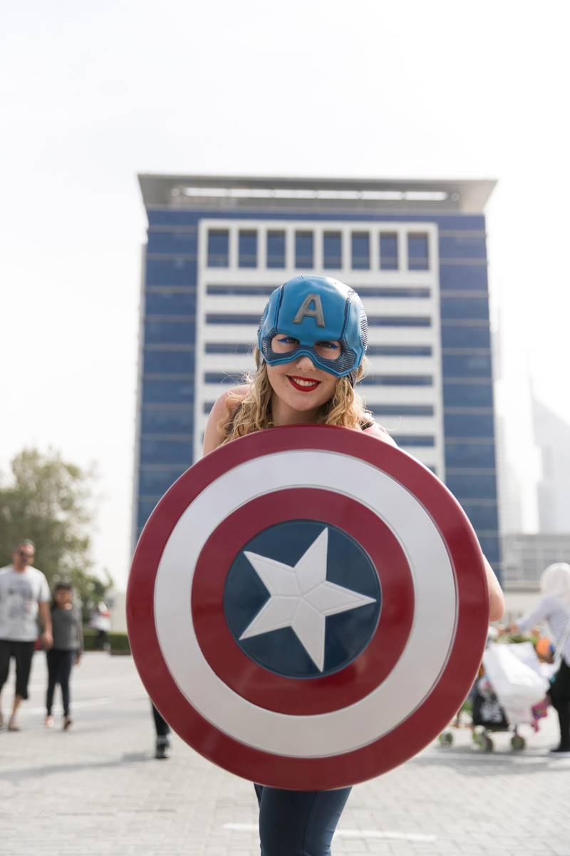 DUBAI, UNITED ARAB EMIRATES - APRIL 7, 2018.   A girl in Captain America costume at the Middle East Film and Comic Con.  (Photo by Reem Mohammed/The National)  Reporter: Section: NA