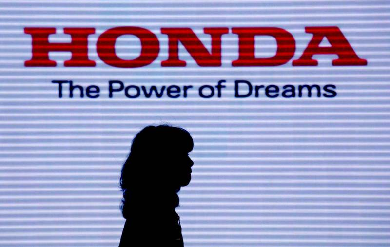 epa08714622 (FILE) - A visitor walks under the logo of Honda Motor Co. at the company headquarters in Tokyo, Japan, 29 July 2014 (reissued 02 october 2020). According to media reports, Honda announced it will quit Formula 1 to focus on carbon neutrality at the end of the 2021 season, forcing Alpha Tauri and Red Bull to look for a new engine provider for 2022.  EPA/KIMIMASA MAYAMA