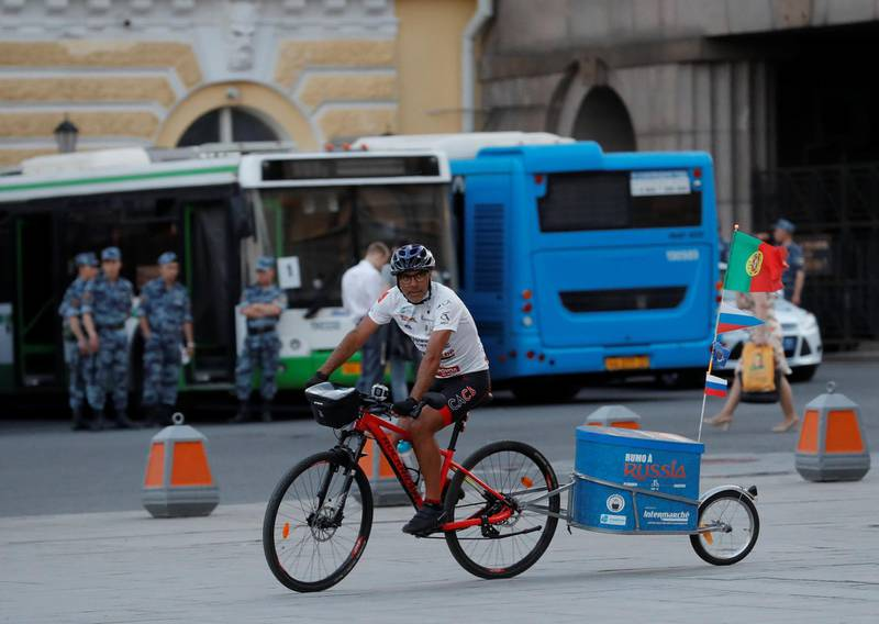 Portuguese cyclist Helder Batista, who arrived in Russia's capital to attend the 2018 FIFA World Cup, rides his bike in central Moscow, Russia June 18, 2018. REUTERS/Tatyana Makeyeva