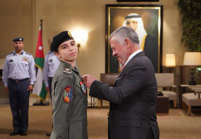 """A handout picture released by the Jordanian Royal Palace on January 8, 2020 shows Jordanian King Abdullah II (R) presenting Princess Salma bint Abdullah with her wings after completing her pilot training in the capital Amman.  - RESTRICTED TO EDITORIAL USE - MANDATORY CREDIT """"AFP PHOTO / JORDANIAN ROYAL PALACE / YOUSEF ALLAN"""" - NO MARKETING NO ADVERTISING CAMPAIGNS - DISTRIBUTED AS A SERVICE TO CLIENTS  / AFP / Jordanian Royal Palace / Yousef ALLAN / RESTRICTED TO EDITORIAL USE - MANDATORY CREDIT """"AFP PHOTO / JORDANIAN ROYAL PALACE / YOUSEF ALLAN"""" - NO MARKETING NO ADVERTISING CAMPAIGNS - DISTRIBUTED AS A SERVICE TO CLIENTS"""