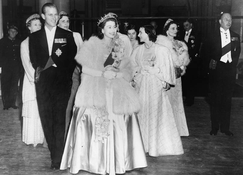 HM Queen Elizabeth II and Prince Philip, the Duke of Edinburgh, wearing formal dress as they attend a concert at Festival Hall, London, May 1951. (Photo by Hulton Archive/Getty Images)