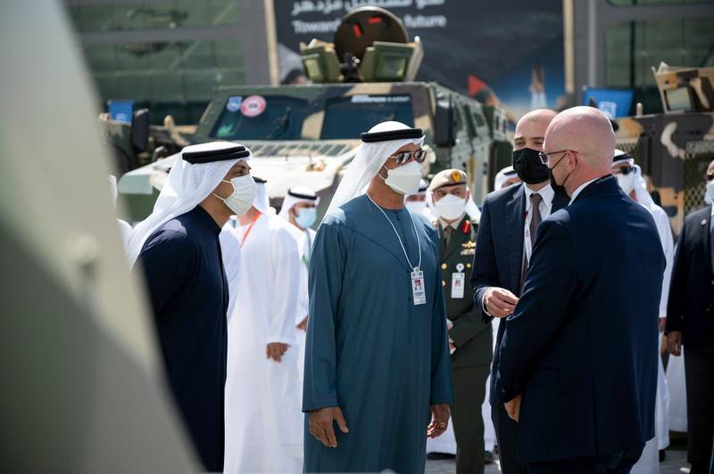 ABU DHABI, UNITED ARAB EMIRATES - February 22, 2021: HH Sheikh Mohamed bin Zayed Al Nahyan, Crown Prince of Abu Dhabi and Deputy Supreme Commander of the UAE Armed Forces (2nd L) tours the International Defence Exhibition and Conference (IDEX), at ADNEC. Seen with HH Sheikh Mansour bin Zayed Al Nahyan, UAE Deputy Prime Minister and Minister of Presidential Affairs (L).  ( Rashed Al Mansoori / Ministry of Presidential Affairs ) ---