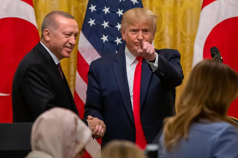 epaselect epa07994088 US President Donald J. Trump (R) and Turkish President Recep Tayyip Erdogan (L) finish a joint press conference in the East Room of the White House in Washington, DC, USA, 13 November 2019. The visit comes one month after Turkey's invasion into northern Syria against the Kurds and on the first day of public impeachment hearings.  EPA/ERIK S. LESSER
