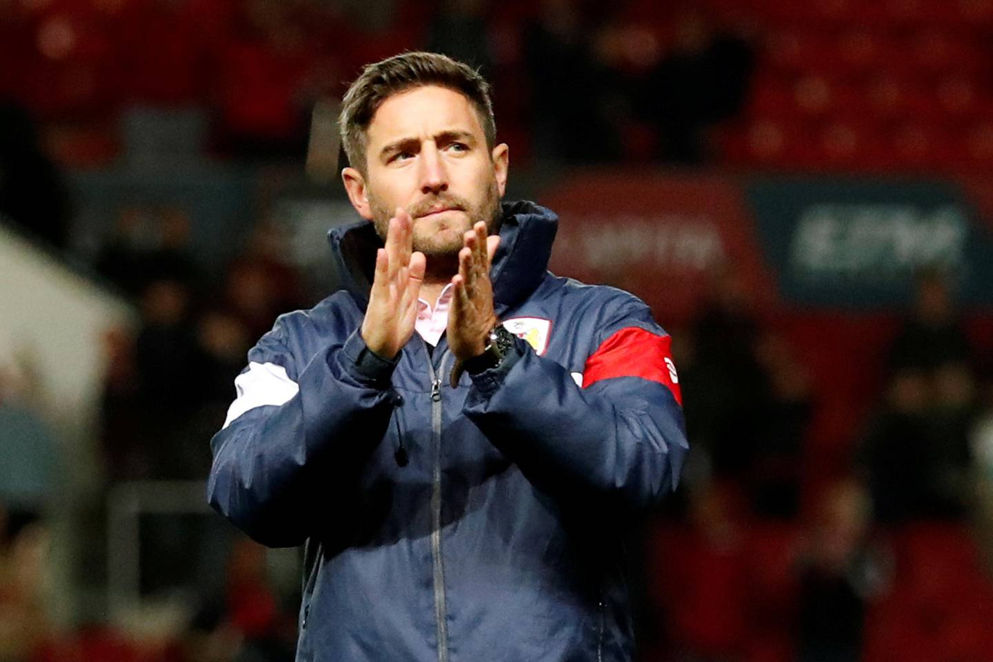 """Soccer Football - Carabao Cup Third Round - Bristol City vs Stoke City - Ashton Gate Stadium, Bristol, Britain - September 19, 2017  Bristol City manager Lee Johnson applauds the fans after the match   Action Images via Reuters/Andrew Boyers   EDITORIAL USE ONLY. No use with unauthorized audio, video, data, fixture lists, club/league logos or """"live"""" services. Online in-match use limited to 75 images, no video emulation. No use in betting, games or single club/league/player publications. Please contact your account representative for further details."""