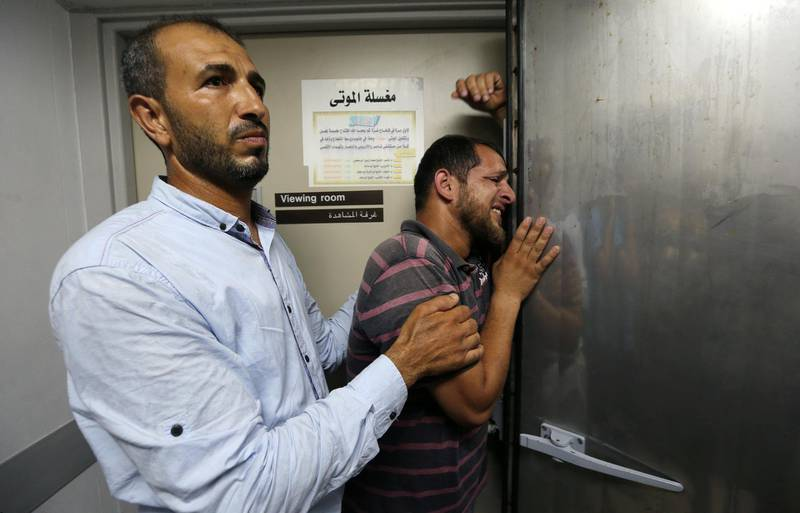 A relative of a Palestinian who was killed by Israeli troops east of Khan Younis, reacts at hospital in the central Gaza Strip  July 20, 2018. REUTERS/Ibraheem Abu Mustafa      TPX IMAGES OF THE DAY