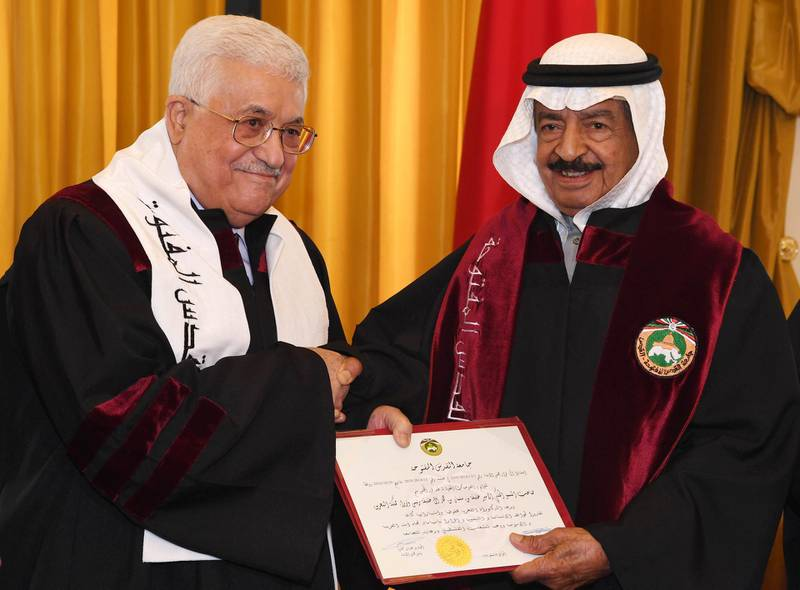 """A handout picture provided by the Palestinian Authority's press office (PPO) on April 11, 2017 shows Palestinian leader Mahmud Abbas (L) shaking hands with Bahraini Prime Minister Sheikh Khalifa bin Salman in Manama. -  (Photo by THAER GHANAIM / various sources / AFP) / === RESTRICTED TO EDITORIAL USE - MANDATORY CREDIT """"AFP PHOTO / HO / PPO """" - NO MARKETING NO ADVERTISING CAMPAIGNS - DISTRIBUTED AS A SERVICE TO CLIENTS ==="""