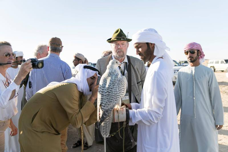 ABU DHABI, UNITED ARAB EMIRATES - DEC 6, 2017Karl Pock from Austria, on a habara hunting trip at the fourth International Festival of Falconry. Karl is one of the original 27 falconers that were in Abu Dhabi in 1976 to receive Sheikh Zayed's invitation to falconers from around the world to convene in the desert of Abu Dhabi and build a strategy for the sport's development.(Photo by Reem Mohammed/The National)Reporter: Anna ZachariasSection: NA