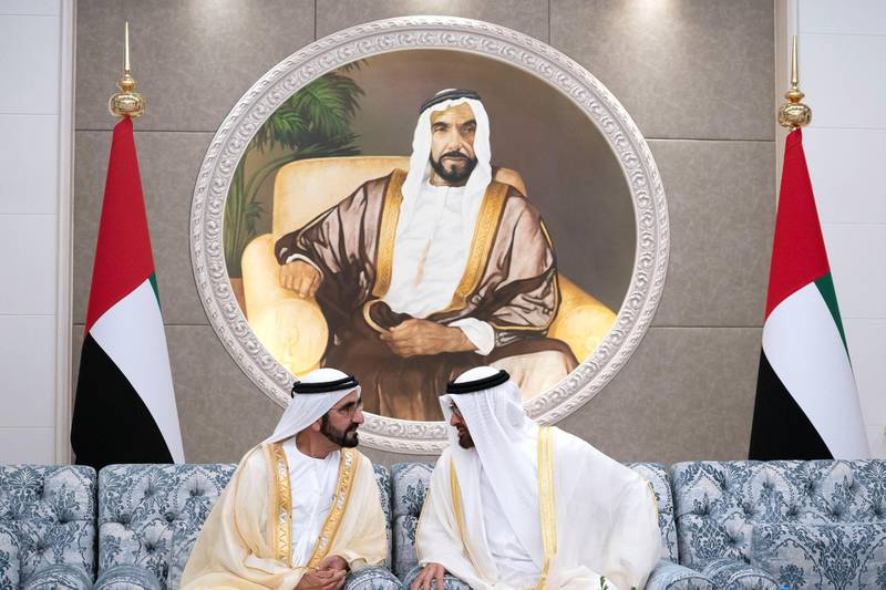 ABU DHABI, UNITED ARAB EMIRATES - August 21, 2018: HH Sheikh Mohamed bin Zayed Al Nahyan Crown Prince of Abu Dhabi Deputy Supreme Commander of the UAE Armed Forces (R) speaks with HH Sheikh Mohamed bin Rashid Al Maktoum, Vice-President, Prime Minister of the UAE, Ruler of Dubai and Minister of Defence (L), during an Eid Al Adha reception at Mushrif Palace.    ( Hamad Al Kaabi / Crown Prince Court - Abu Dhabi ) ---