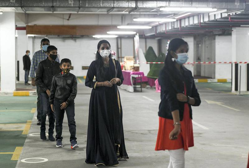 Abu Dhabi, United Arab Emirates - Parishioners must wear mask at all times, maintain two-metre distance, and are asked to come early to prevent crowding at the entrance for midnight mass at St. PaulÕs Catholic Church, in Mussafah. Khushnum Bhandari for The National