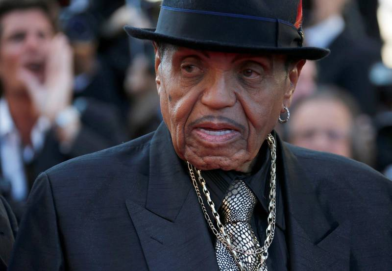 """FILE PHOTO: Joe Jackson, father of the late pop star Michael Jackson, poses on the red carpet as he arrives for the screening of the film """"Sils Maria"""" (Clouds of Sils Maria) in competition at the 67th Cannes Film Festival in Cannes, France, May 23, 2014.     REUTERS/Regis Duvignau/File Photo"""