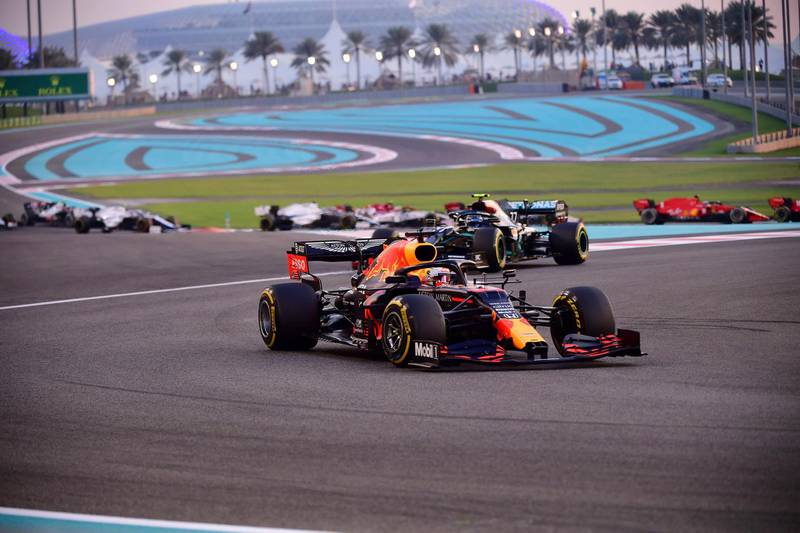Red Bull driver Max Verstappen of the Netherlands leeads at the start of the Formula One Abu Dhabi Grand Prix in Abu Dhabi, United Arab Emirates, Sunday, Dec. 13, 2020. (Giuseppe Cacace, Pool via AP)