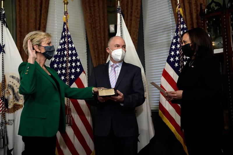 epa09037216 US Secretary of Energy Jennifer Granholm (L) is sworn in with her husband Dan Mulhern by Vice President Kamala Harris during a ceremony in the Eisenhower Executive Office Building at the White House in Washington, DC, USA, 25 February 2021.  EPA/Yuri Gripas / POOL