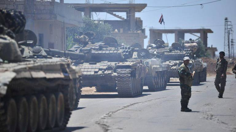 An image that illustrates this article Syrian regime re-enters Deraa to end fighting after Russian deal