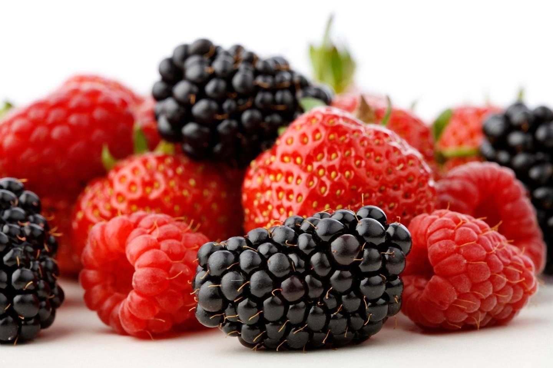 Fresh Mixed berries - strawberries, blackberries and raspberries isolated on white background (iStockphoto.com)