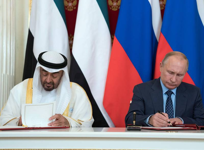 MOSCOW, RUSSIA - June 01, 2018: HH Sheikh Mohamed bin Zayed Al Nahyan, Crown Prince of Abu Dhabi and Deputy Supreme Commander of the UAE Armed Forces (L) and  HE Vladimir Putin Vladimirovich, President of Russia (R) sign a memorandum of understanding, at the Kremlin Palace.  ( Mohamed Al Hammadi / Crown Prince Court - Abu Dhabi ) ---