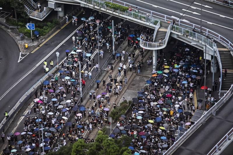 Demonstrators march along Queensway during a protest in the Central district of Hong Kong, China, on Sunday, Sept. 15, 2019. Tens of thousands of protesters marched through central Hong Kong, defying a police ban on a mass rally that had been planned for Sunday afternoon. Photographer: Justin Chin/Bloomberg