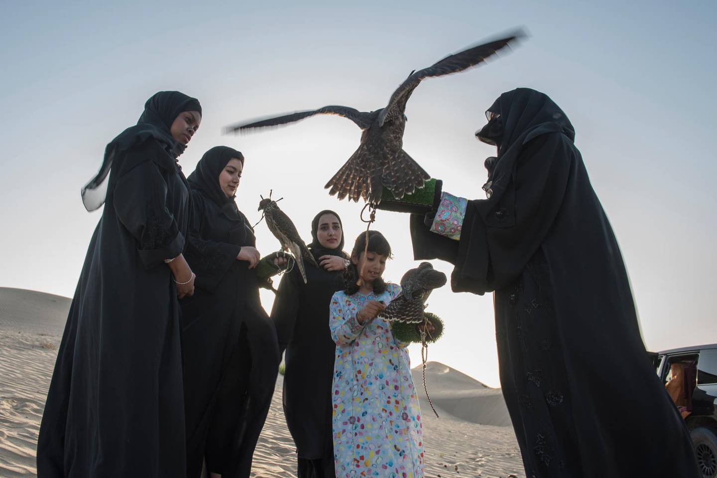 Emirati Women regularly come together in the evenings to meet and train their birds where the practice becomes more about friendship and sharing knowledge than subsistence. (From left to right) Mariam Al Hammadi, Emam Al Hammadi, Khawla Al Hammadi, Osha Khaleefa Al Mansoori, Ayesha Al Manoori head trainer for the female section in Abu Dhabi Falcon Club, a government-owned organization which promotes falconry in UAE.Vidhyaa for The National