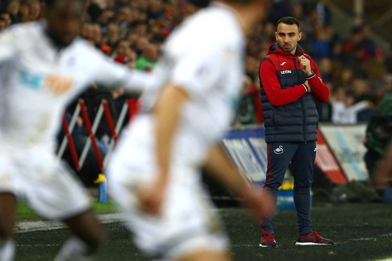 Swansea City's Interim manager Leon Britton watches from the touchline during the English Premier League football match between Swansea City and Crystal Palace at The Liberty Stadium in Swansea, south Wales on December 23, 2017. The game finished 1-1. / AFP PHOTO / Geoff CADDICK / RESTRICTED TO EDITORIAL USE. No use with unauthorized audio, video, data, fixture lists, club/league logos or 'live' services. Online in-match use limited to 75 images, no video emulation. No use in betting, games or single club/league/player publications.  /
