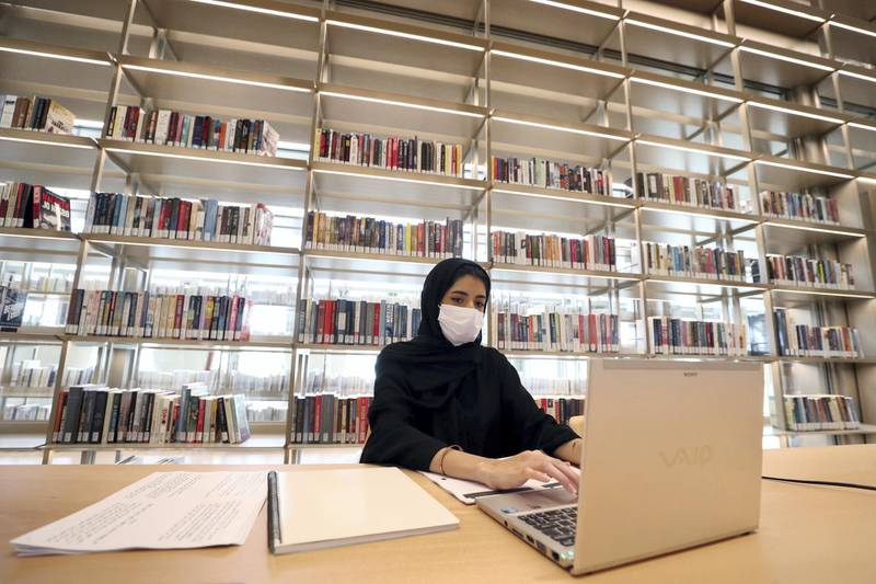 Sharjah, United Arab Emirates - December 10, 2020: News. Arts. Sara works on her laptop. Opening of the House of Wisdom, a high tech new library. Thursday, December 10th, 2020 in Sharjah. Chris Whiteoak / The National