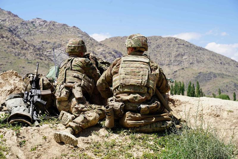 (FILES) In this file photo taken on June 6, 2019, US soldiers look out over hillsides during a visit of the commander of US and NATO forces in Afghanistan General Scott Miller at the Afghan National Army (ANA) checkpoint in Nerkh district of Wardak province. Senior US officials insisted that progress was being made in Afghanistan despite clear evidence the war there had become unwinnable, The Washington Post reported on December 9, 2019 after obtaining thousands of US government documents on the conflict. The Post said it had collected more than 2,000 pages of notes of interviews with top US military officers and diplomats, aid workers, Afghan officials and others who played a direct role in the nearly two-decade-old war.  -   / AFP / THOMAS WATKINS
