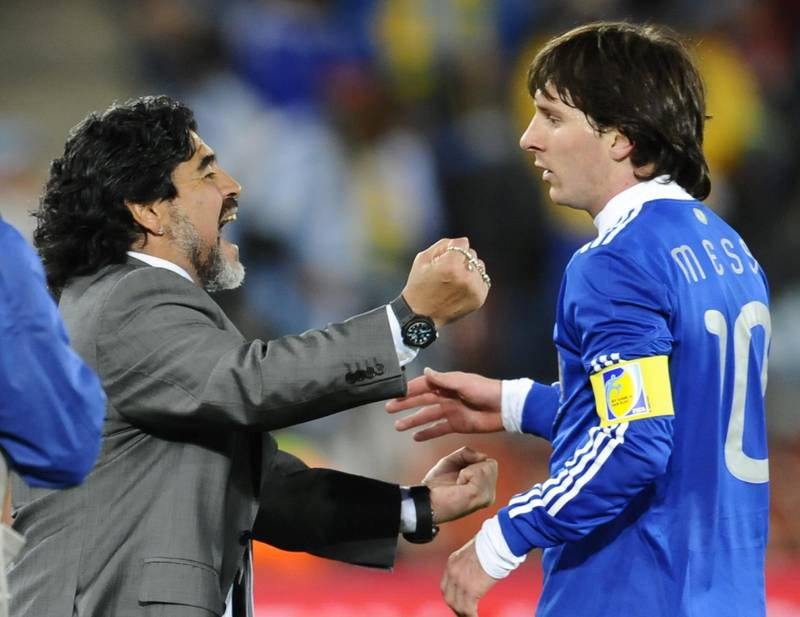Argentina's striker Lionel Messi (R) celebrates with Argentina's coach Diego Maradona at the end of the Group B first round 2010 World Cup football match Greece vs Argentina on June 22, 2010 at Peter Mokaba stadium in Polokwane. Argentina defeated Greece 2-0. NO PUSH TO MOBILE / MOBILE USE SOLELY WITHIN EDITORIAL ARTICLE -      AFP PHOTO / DANIEL GARCIA (Photo by DANIEL GARCIA / AFP)