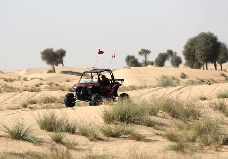 Dubai, United Arab Emirates - December 02, 2020: National Day. People enjoy taking their dune buggy for a spin in the desert on National day. Wednesday, December 2nd, 2020 in Dubai. Chris Whiteoak / The National