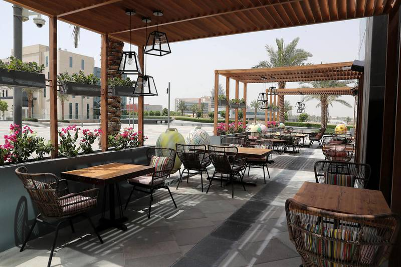 Outdoor sitting area of the Grand Beirut restaurant at Dubai Digital Park in Dubai Silicon Oasis in Dubai on June 22,2021. Pawan Singh / The National. Story by Janice Rodrigues