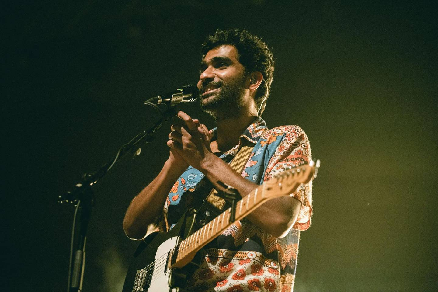 """In this handout photograph taken in December 2019 and released on January 3, 2020, singer Prateek Kuhad reacts as he performs on stage in New Delhi. Starting out, Indian singer Prateek Kuhad gave himself one year to make it. He is still no stranger to self-doubt -- but now even Barack Obama is a fan of his heartbreak-inspired songs.  - RESTRICTED TO EDITORIAL USE - MANDATORY CREDIT """"AFP PHOTO / Prashin Jagger"""" - NO MARKETING NO ADVERTISING CAMPAIGNS - DISTRIBUTED AS A SERVICE TO CLIENTS --- NO ARCHIVE --- To go with 'INDIA-MUSIC-CELEBRITY-KUHAD-OBAMA' by Aishwarya Kumar  / AFP / Prashin Jagger / RESTRICTED TO EDITORIAL USE - MANDATORY CREDIT """"AFP PHOTO / Prashin Jagger"""" - NO MARKETING NO ADVERTISING CAMPAIGNS - DISTRIBUTED AS A SERVICE TO CLIENTS --- NO ARCHIVE --- To go with 'INDIA-MUSIC-CELEBRITY-KUHAD-OBAMA' by Aishwarya Kumar"""