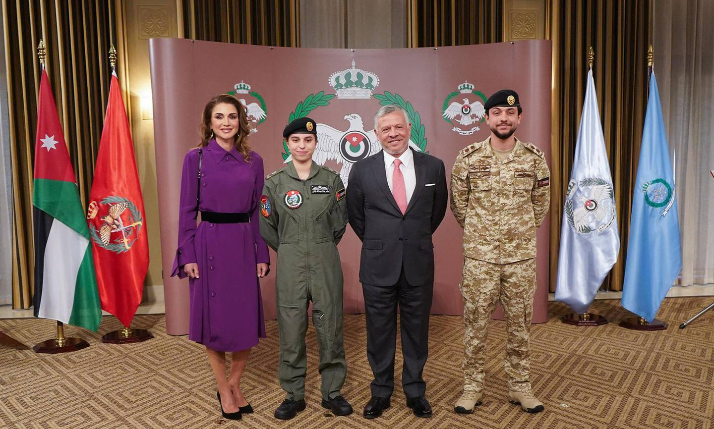 """A handout picture released by the Jordanian Royal Palace on January 8, 2020 shows Jordanian King Abdullah II (C-R) posing for a picture with his son Crown Prince Hussein (R) and his wife Queen Rania (L) after presenting his daughter Princess Salma bint Abdullah (C-L) with her wings for completing her pilot training in the capital Amman.  - RESTRICTED TO EDITORIAL USE - MANDATORY CREDIT """"AFP PHOTO / JORDANIAN ROYAL PALACE / YOUSEF ALLAN"""" - NO MARKETING NO ADVERTISING CAMPAIGNS - DISTRIBUTED AS A SERVICE TO CLIENTS  / AFP / Jordanian Royal Palace / Yousef ALLAN / RESTRICTED TO EDITORIAL USE - MANDATORY CREDIT """"AFP PHOTO / JORDANIAN ROYAL PALACE / YOUSEF ALLAN"""" - NO MARKETING NO ADVERTISING CAMPAIGNS - DISTRIBUTED AS A SERVICE TO CLIENTS"""