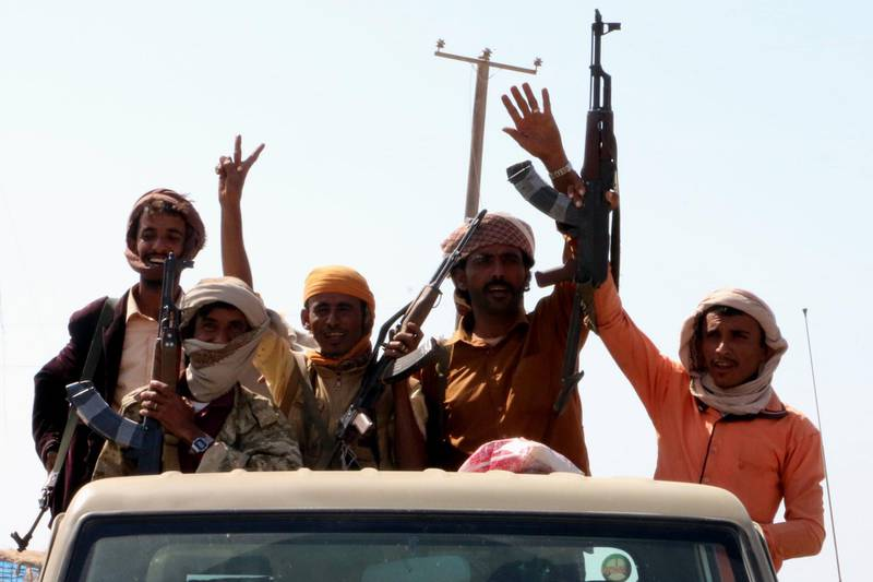 epa06383441 Armed members of Yemen's Saudi-backed forces celebrate after seizing a strategic town from the Houthi rebels in the western province of Hodeidah, Yemen, 11 December 2017. According to reports, Yemeni army forces and the Popular Resistance militiamen, with the air support by the Saudi-led military coalition, have made rapid advances in recent days in Hodeidah province, on Yemen's Red Sea coast, beginning with the capture of Al-Khokha following fierce battles with the Houthis.  EPA/STRINGER
