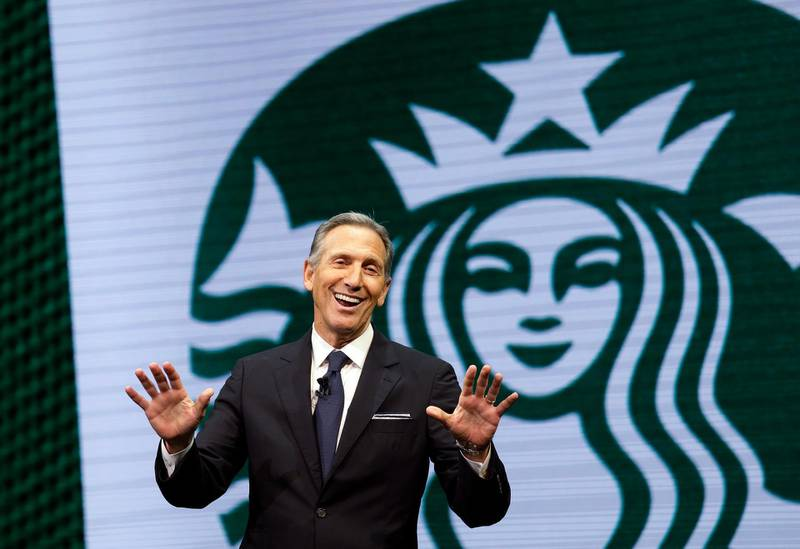 """FILE - In this March 22, 2017 file photo, Starbucks CEO Howard Schultz speaks at the Starbucks annual shareholders meeting in Seattle. Schultz says the company will now allow people to use bathrooms at its coffee shops even if they don't buy anything, as it continues to take a closer look at its operations following the arrest of two black men at a Philadelphia shop. Schulz discussed the new policy while he spoke at the Atlantic Council in Washington, Thursday, May 10, 2018. Schultz said the company previously had a """"loose policy"""" that only paying customers be allowed to use bathrooms, but that it was up to each store manager to decide. (AP Photo/Elaine Thompson, File)"""