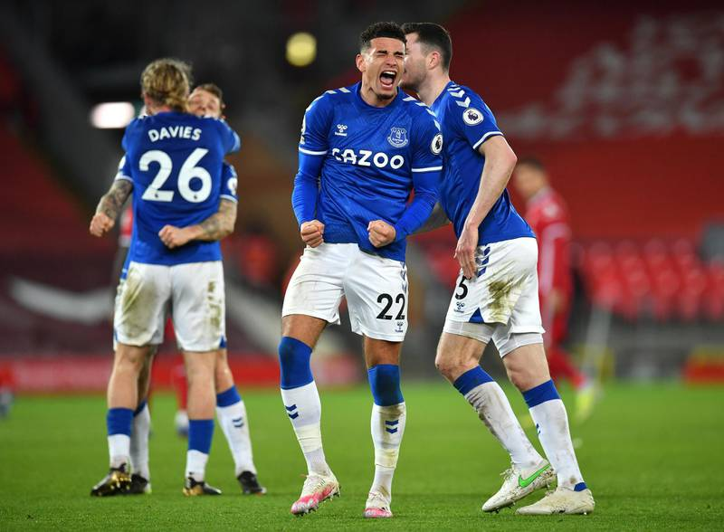 LIVERPOOL, ENGLAND - FEBRUARY 20: Ben Godfrey and Michael Keane of Everton celebrate following their team's victory in the Premier League match between Liverpool and Everton at Anfield on February 20, 2021 in Liverpool, England. Sporting stadiums around the UK remain under strict restrictions due to the Coronavirus Pandemic as Government social distancing laws prohibit fans inside venues resulting in games being played behind closed doors. (Photo by Paul Ellis - Pool/Getty Images)