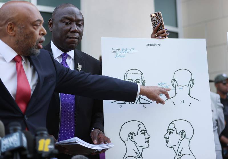 ELIZABETH CITY, NORTH CAROLINA - APRIL 27: Benjamin Crump and Wayne Kendall (L), lawyers representing the family of Andrew Brown Jr., stand with an autopsy chart that their team conducted showing where Mr. Brown was shot on April 27, 2021 in Elizabeth City, North Carolina. Mr. Kendall and family members spoke to the media about the 20 seconds of police body camera footage they were shown and an autopsy they performed after the shooting death of Andrew Brown Jr. on April 21 by Pasquotank County Sheriff deputies.   Joe Raedle/Getty Images/AFP == FOR NEWSPAPERS, INTERNET, TELCOS & TELEVISION USE ONLY ==