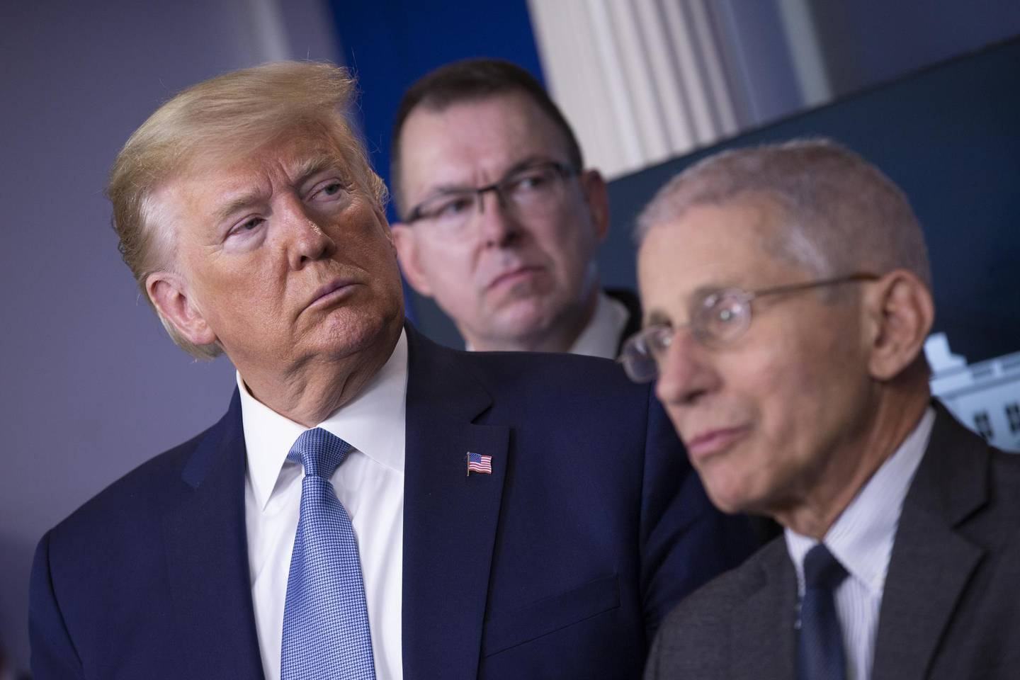 """U.S. President Donald Trump, left, listens during a Coronavirus Task Force news conference in the briefing room of the White House in Washington, D.C., U.S., on Saturday, March 21, 2020. Trump said negotiators in Congress and his administration are """"very close"""" to agreement on a coronavirus economic-relief plan that his economic adviser said will aim to boost the U.S. economy by about $2 trillion. Photographer: Stefani Reynolds/CNP/Bloomberg"""