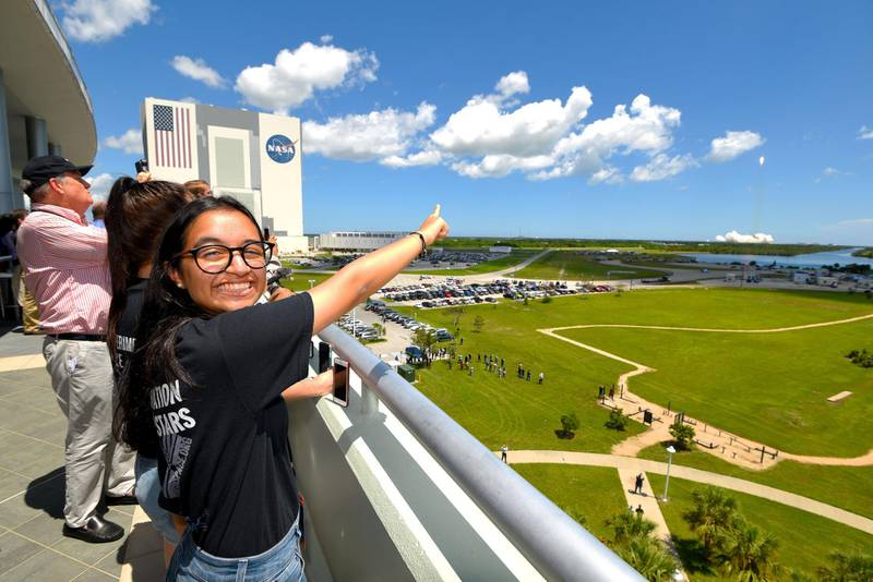 Al Mansoori watches a SpaceX Falcon 9 rocket launch from Kennedy Space Center carrying her Genes in Space experiment to the International Space Station on Aug. 14, 2017 in {town}, Florida. (Scott A. Miller for The National)