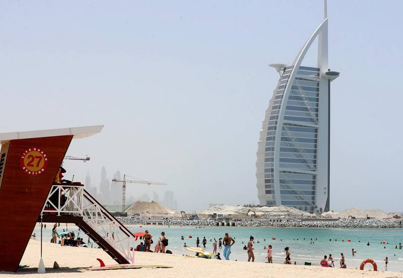 Dubai, United Arab Emirates - Reporter: N/A: News. The public beach next to the Burj Al Arab is busy as beaches in Dubai re open for the second day. Saturday, May 30th, 2020. Dubai. Chris Whiteoak / The National