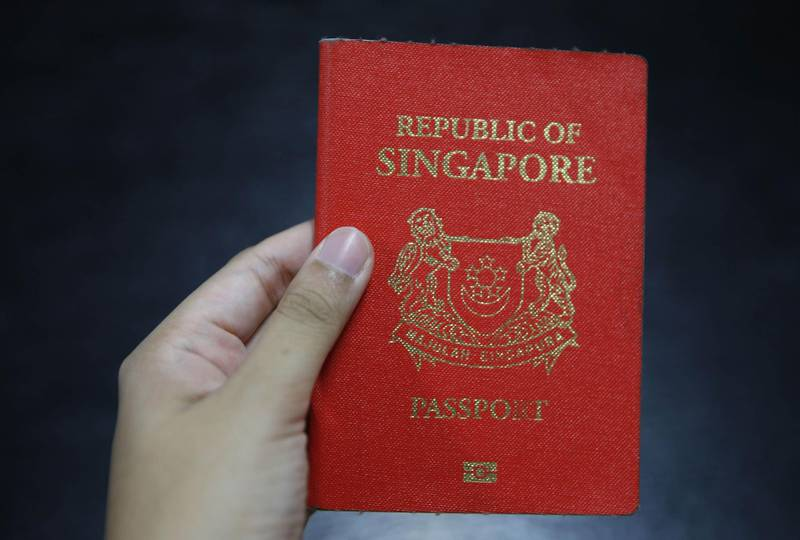 Mandatory Credit: Photo by Wallace Woon/EPA-EFE/Shutterstock (9177527d)A Singapore passport is held up in Singapore, 28 October 2017. For the first time, Singapore is the single most powerful passport in the world. By removing visa requirements for Singaporeans, Paraguay helped Singapore edge out Germany for the top spot in a passport index developed by global financial advisory firm Arton Capital. Historically, the top ten most powerful passports in the world were mostly European, with Germany having the lead for the past two years.Singapore edge out Germany for most powerful passport - 28 Oct 2017