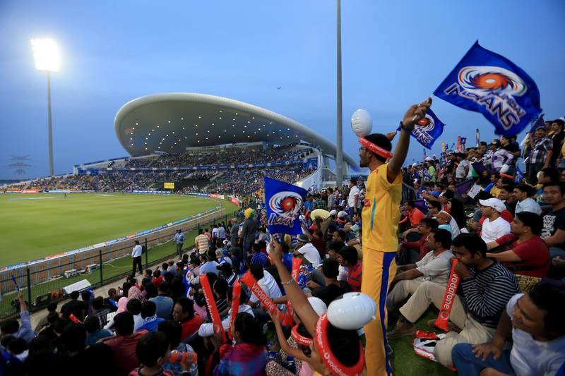ABU DHABI - UNITED ARAB EMIRATES - 16APR2014 - IPL fans cheer during the first match of IPL 2014 yesterday at Zayed Cricket Stadium in Abu Dhabi. Ravindranath K / The National