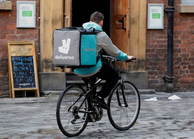 FILE PHOTO: A deliveroo worker cycles along a pedestrianised road in Liverpool, Britain, October 18, 2017. Picture taken October 18, 2017.     REUTERS/Phil Noble/File Photo