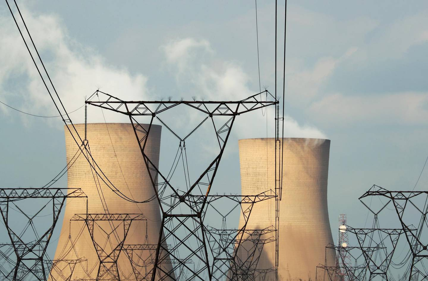 FILE PHOTO: Cooling towers are pictured at a coal-based power station owned by state power utility Eskom in Duhva, South Africa, February 18, 2020.  Picture taken February 18, 2020. REUTERS/Mike Hutchings/File Photo