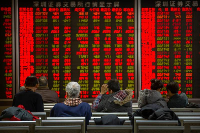 Chinese investors monitor stock prices at a brokerage house in Bejiing, Thursday, Dec. 26, 2019. Shares are mostly higher in Asia with many world markets closed for Christmas holidays. (AP Photo/Mark Schiefelbein)
