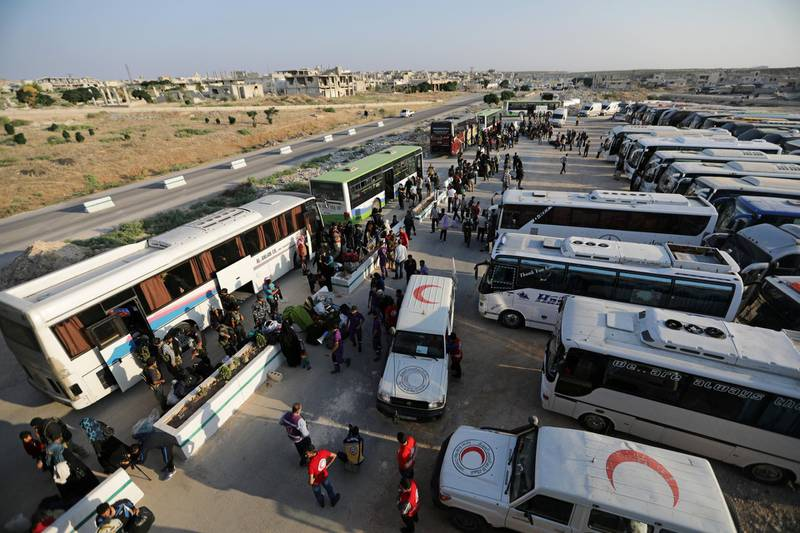 Rebels and civilians arrive in Hama from Deraa, Syria July 21,2018.REUTERS/ Khalil Ashawi