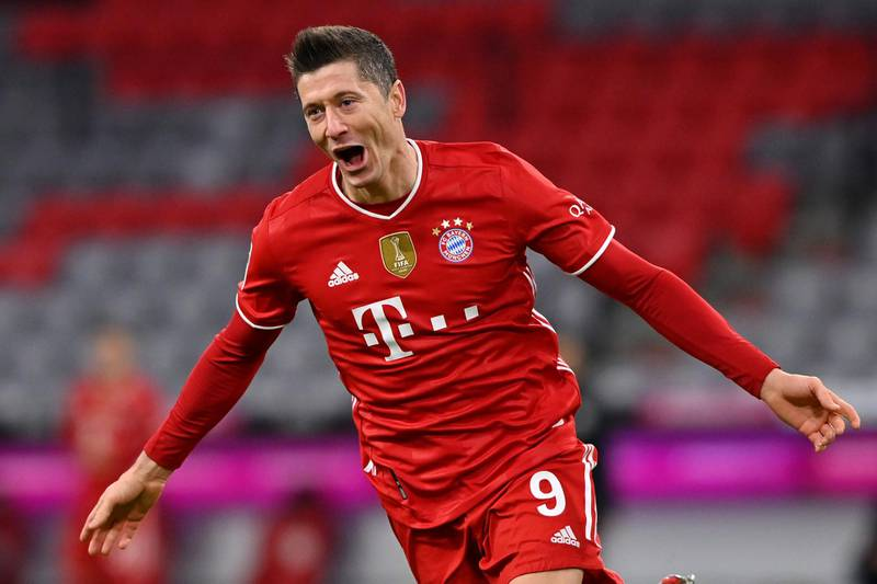 *** BESTPIX *** MUNICH, GERMANY - MARCH 06: Robert Lewandowski of FC Bayern Muenchen celebrates after scoring their team's fourth goal, completing his hat-trick during the Bundesliga match between FC Bayern Muenchen and Borussia Dortmund at Allianz Arena on March 06, 2021 in Munich, Germany. Sporting stadiums around Germany remain under strict restrictions due to the Coronavirus Pandemic as Government social distancing laws prohibit fans inside venues resulting in games being played behind closed doors. (Photo by Sebastian Widmann/Getty Images)