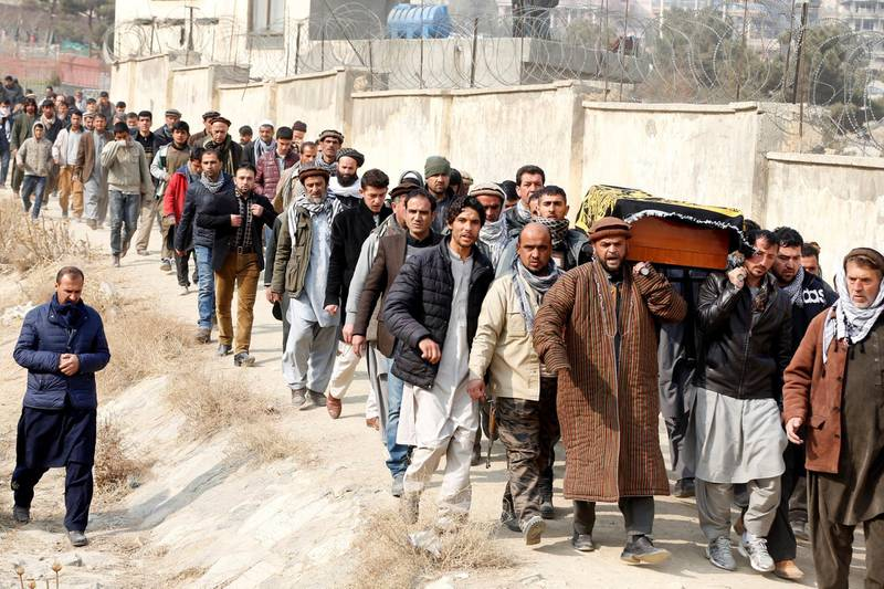 Afghan men carry the coffin of one of the victims of yesterday's car bomb attack at in Kabul, Afghanistan January 28, 2018. REUTERS/Omar Sobhani