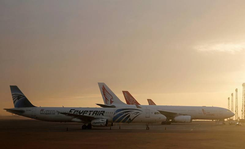 An EgyptAir plane is parked next to other planes on the runway of the Cairo International Airport, pictured through the window of an Etihad Airways plane in Egypt December 16, 2017. Picture taken December 16, 2017. REUTERS/Amr Abdallah Dalsh
