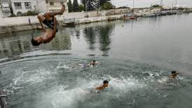 Tunisians struggle to stay cool amid record-breaking heat
