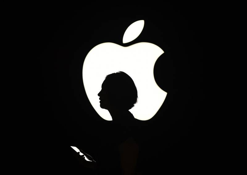(FILES) In this file photo taken on September 9, 2015 a reporter walks by an Apple logo during a media event in San Francisco, California. Apple sent out invitations on August 29, 2019 to a September 10 event at its Silicon Valley campus where it is expected to unveil a new-generation iPhone.In its trademark, tight-lipped style, Apple disclosed little about what it plans to spotlight in the Steve Jobs Theater at its headquarters in the city of Cupertino.For years now, Apple has hosted events in the fall to launch new iPhone models ahead of the Christmas holiday shopping season.  / AFP / Josh Edelson